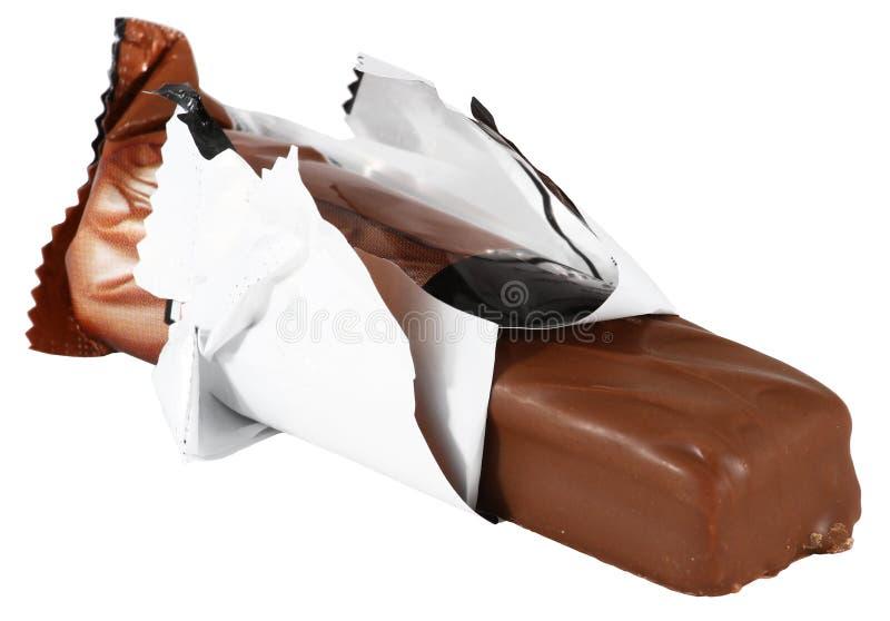 Barra de chocolate con la envoltura imagenes de archivo