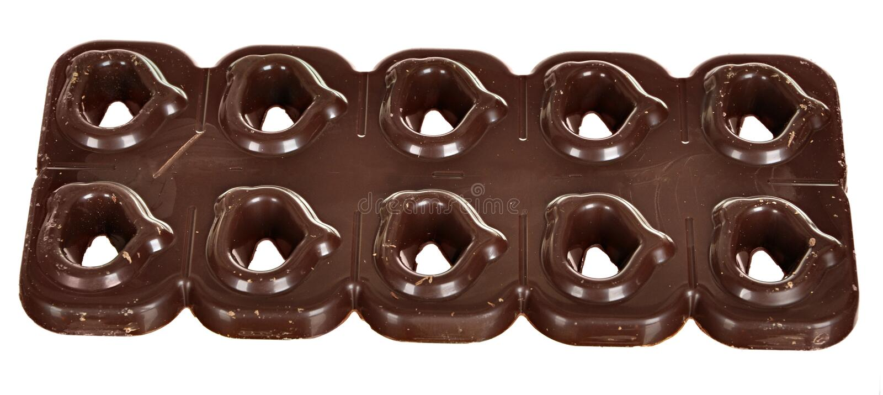 Barra de chocolate oscura como fondo imagen de archivo