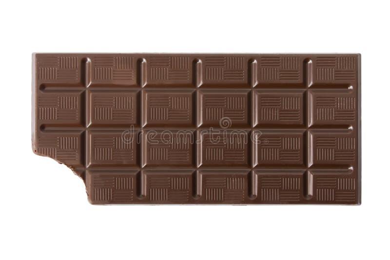 Barra de chocolate oscura mordida imagenes de archivo