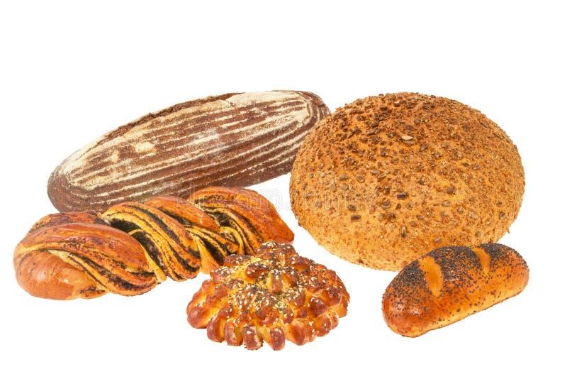 Barra de pan con las semillas y el rollo de sésamo con las semillas de amapola imágenes de archivo libres de regalías