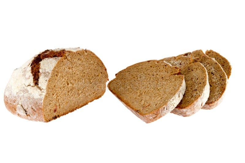 Barra de pan cortada en un fondo blanco fotografía de archivo libre de regalías