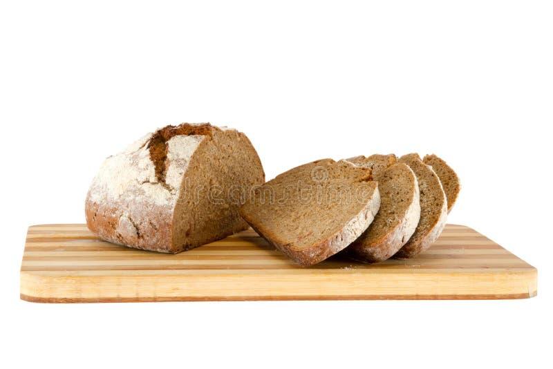 Barra de pan en un tablero de madera fotos de archivo libres de regalías