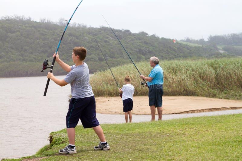 Barra de pesca del bastidor del muchacho foto de archivo libre de regalías