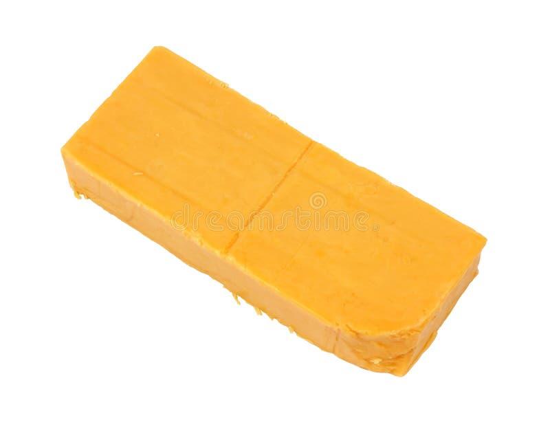 Barra del queso de Cheddar sostenido fotografía de archivo libre de regalías