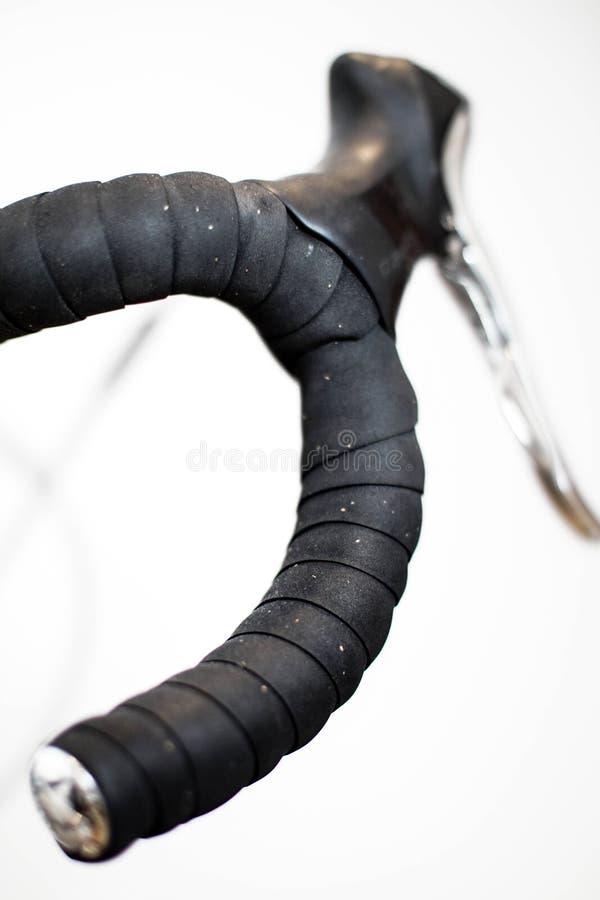 Barra della maniglia della bicicletta con nastro adesivo nero fotografia stock