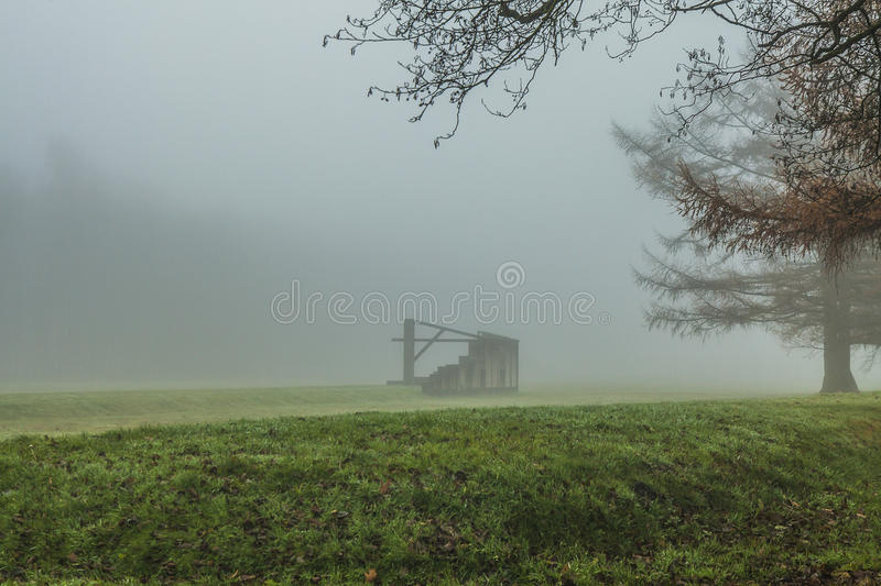 Barrack in fog royalty free stock image