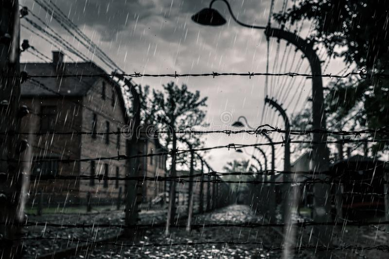 Barracks and fence, German death camp Auschwitz II. Barracks and barbed wire fence, German death camp Auschwitz II, Birkenau, Poland. Museum of victims of the stock image