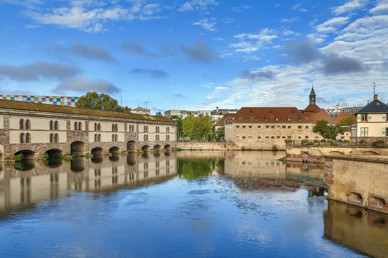 Barrage Vauban, Strasbourg. The Barrage Vauban, or Vauban Dam, is a bridge, weir and defensive work erected in the 17th century on the River Ill in the city of stock photo