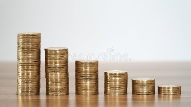Barras apiladas monedas fotografía de archivo libre de regalías