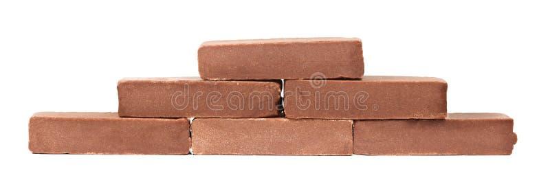 Barras de chocolate sobre o fundo branco imagem de stock royalty free