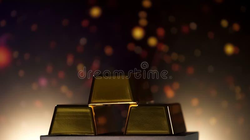 Barras de oro que mienten contra el fondo chispeante, reserva de banco, renta activa foto de archivo libre de regalías