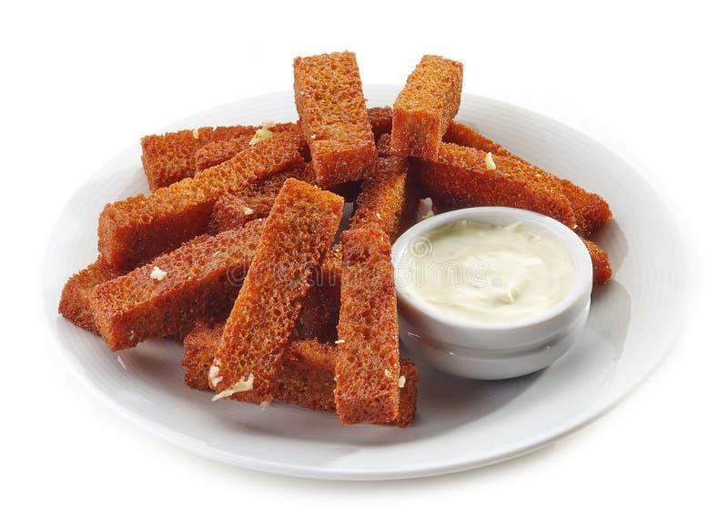 Barras de pan frito con ajo y salsa fotos de archivo libres de regalías