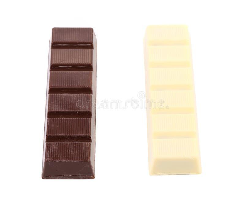 Barras del chocolate oscuras y blancas. imagen de archivo