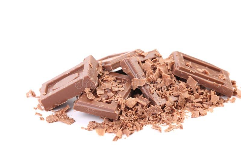 Barras e rapagem de chocolate. fotografia de stock royalty free