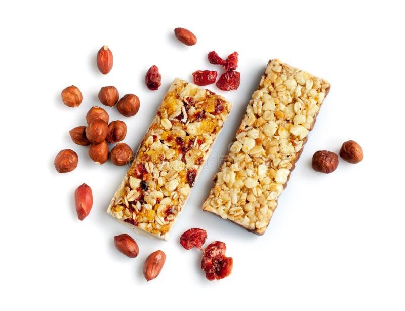 Barras saudáveis do cereal com porcas foto de stock royalty free