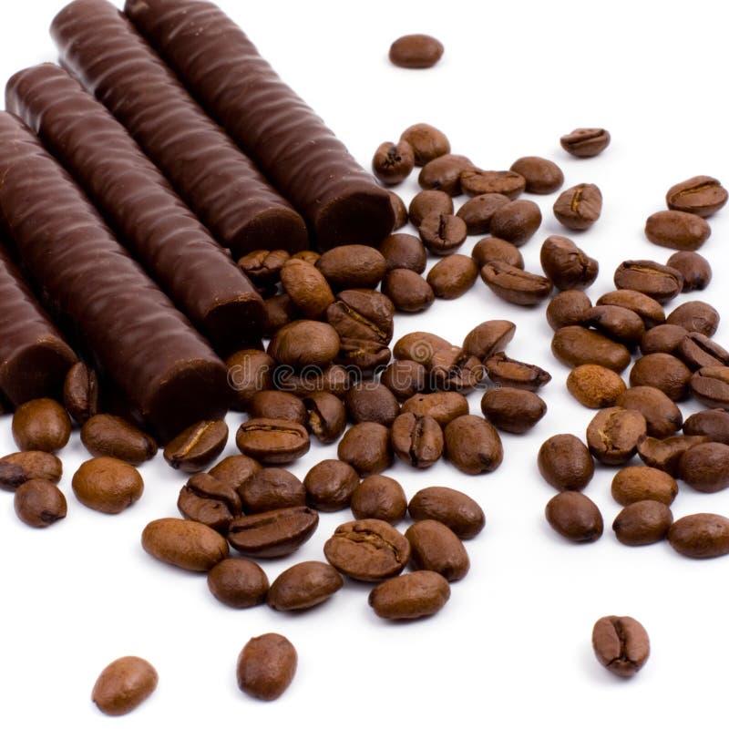 Barras y café de chocolate fotografía de archivo libre de regalías