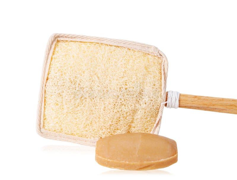 Barre de savon brun naturel et de luffa ou de brosse en bois de luffa pour image libre de droits