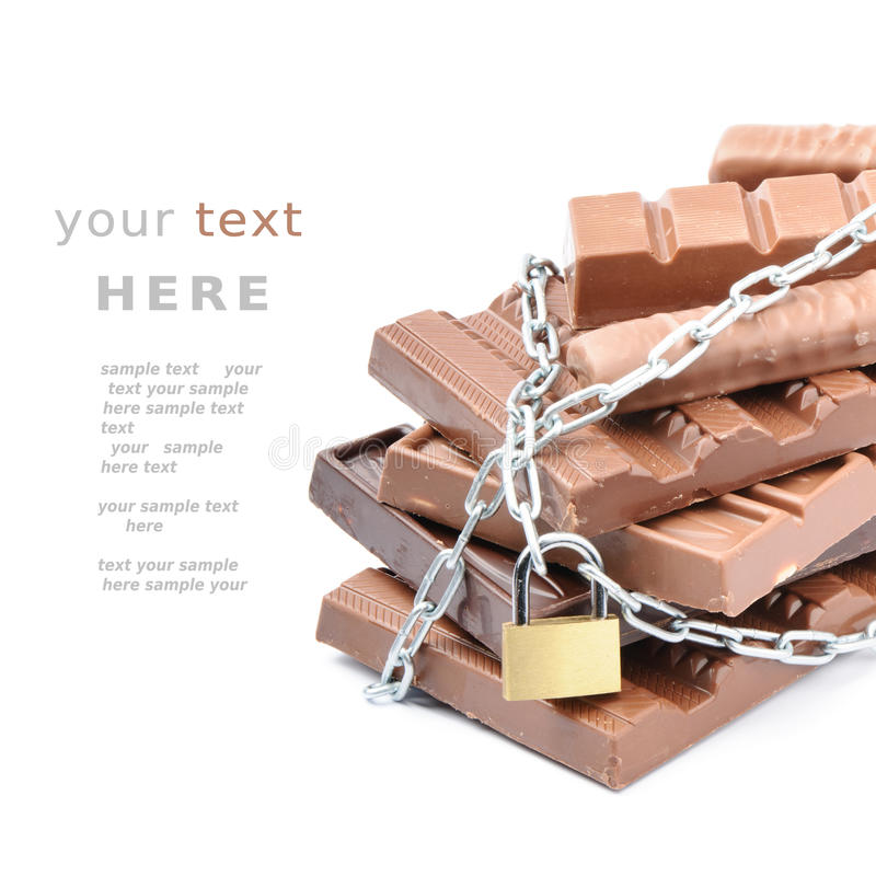 Barre di cioccolato legate in su con le catene immagine stock libera da diritti
