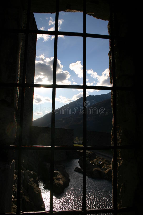 Barred Castle Window Looking Out On Stock Images