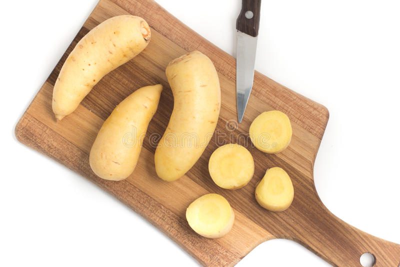 Barred Potato. Baroa. On white background stock photos