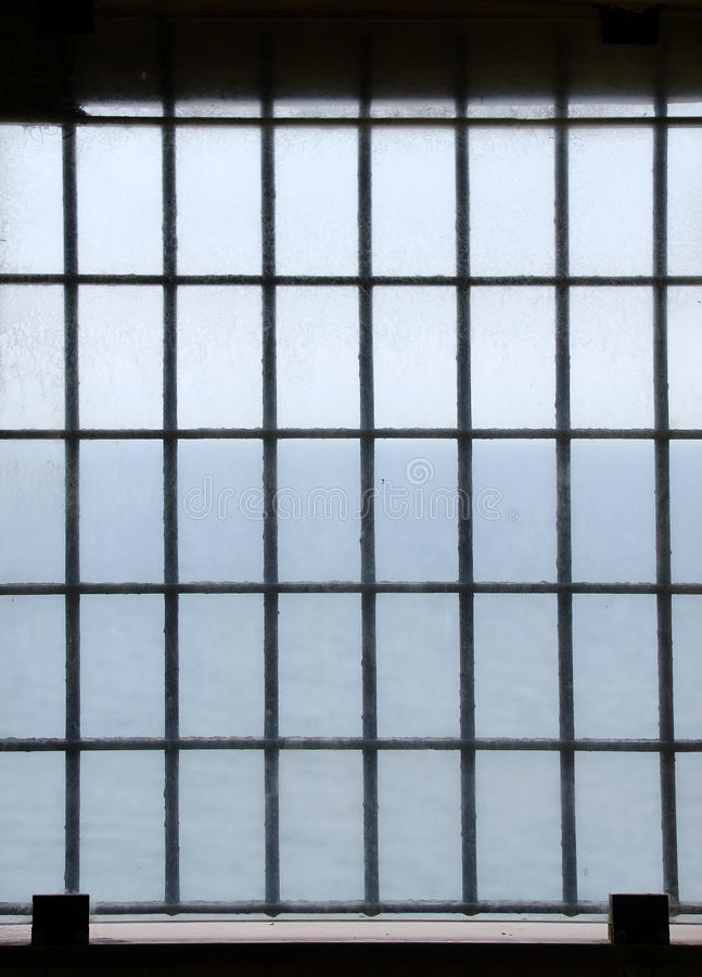 Barred prison window stock image