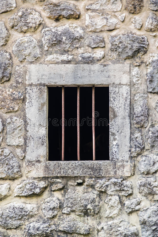 Barred prison window stock photography