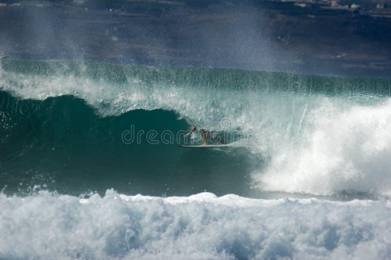 In the barrel. Surfer deep in the barrel of a wave in El Confital in Las Palmas in Gran Canaria stock photo