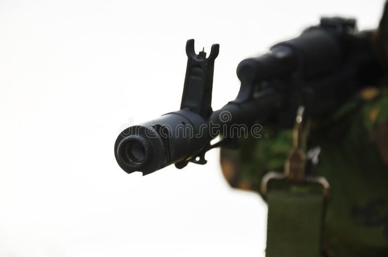 Barrel of the automatic rifle on a white background royalty free stock photography