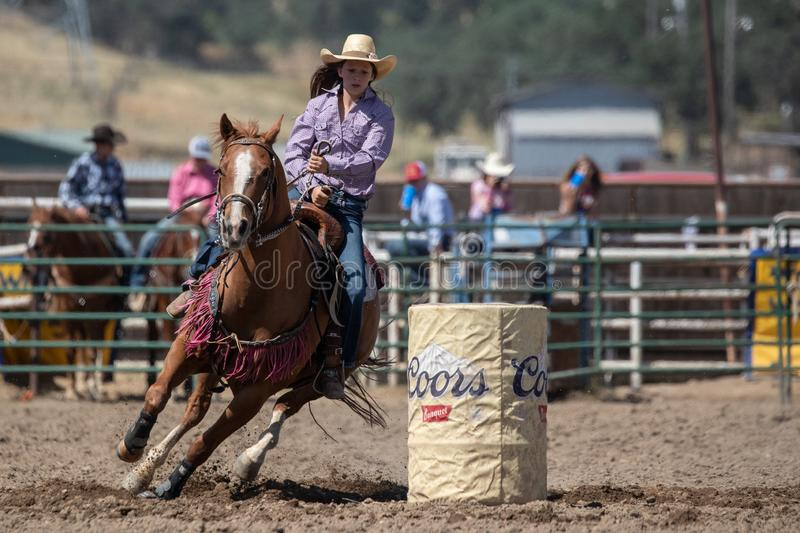 Barrel Racer. Cowgirl barrel racing the clock at the Cottonwood Rodeo in Northern California royalty free stock photos