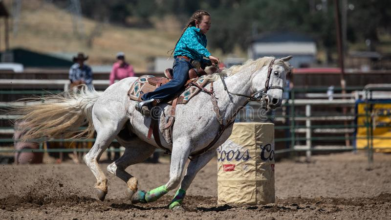 Barrel Racer. Cowgirl barrel racing the clock at the Cottonwood Rodeo in Northern California royalty free stock photo