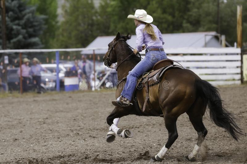 Barrel Racer Flying Across The Arena royalty free stock photography
