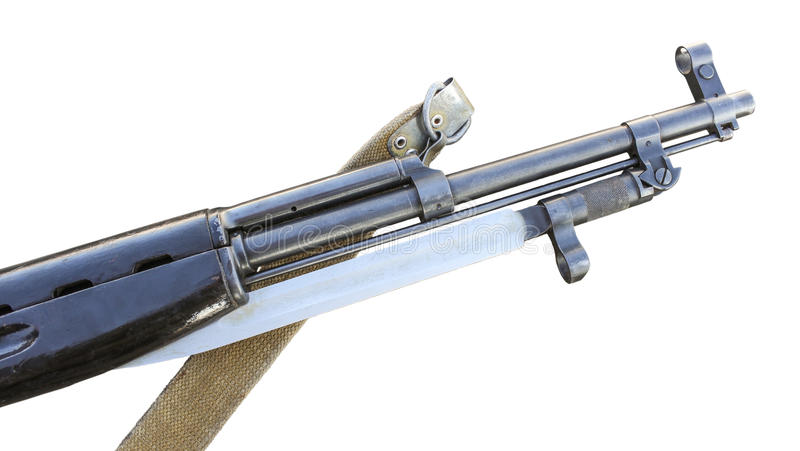 The barrel of the rifle. The trunk of the old Soviet carbine with folded bayonet on a white background stock images
