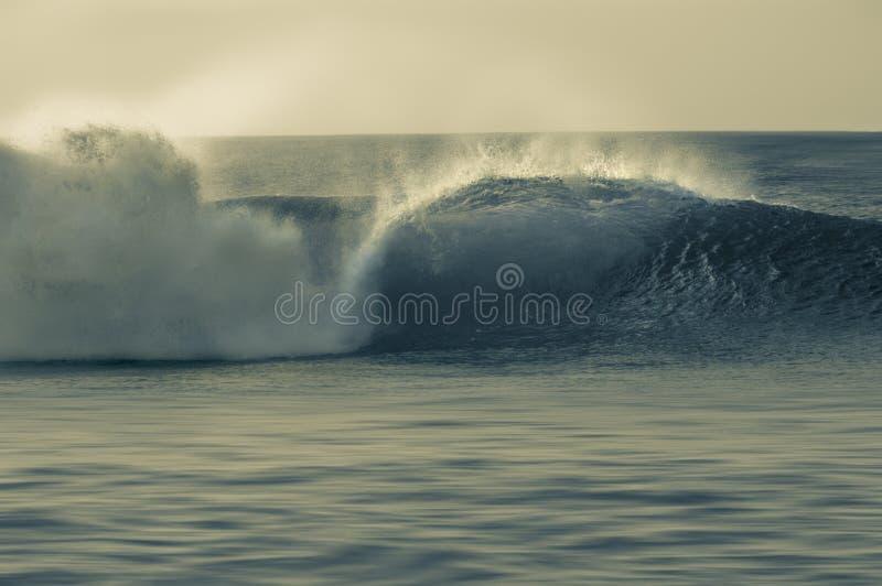 Barrel wave breaking in Pipeline. royalty free stock photos