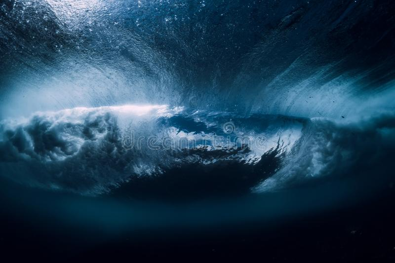 Barrel wave underwater with air bubbles. Ocean in underwater. Barrel wave underwater with air bubbles stock photo