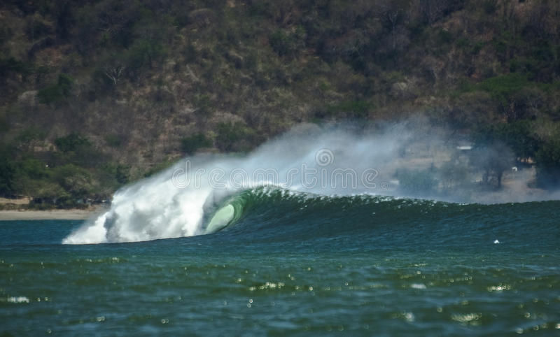 Barreling wave in Central America royalty free stock images