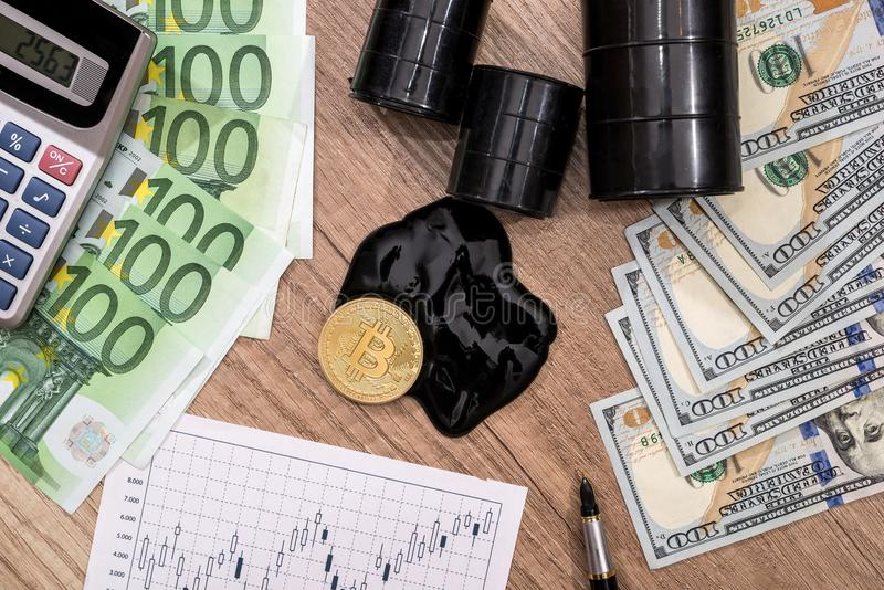 Barrels of oil, dollar, euro bitcoin diagram pen and calculator. Barrels of oil, dollar euro, bitcoin diagram pen and calculator stock photo