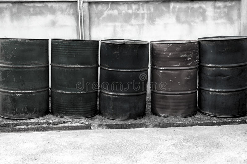 Barrels of oil. Oil Drums -- they are old and rusty and in various colors stock image