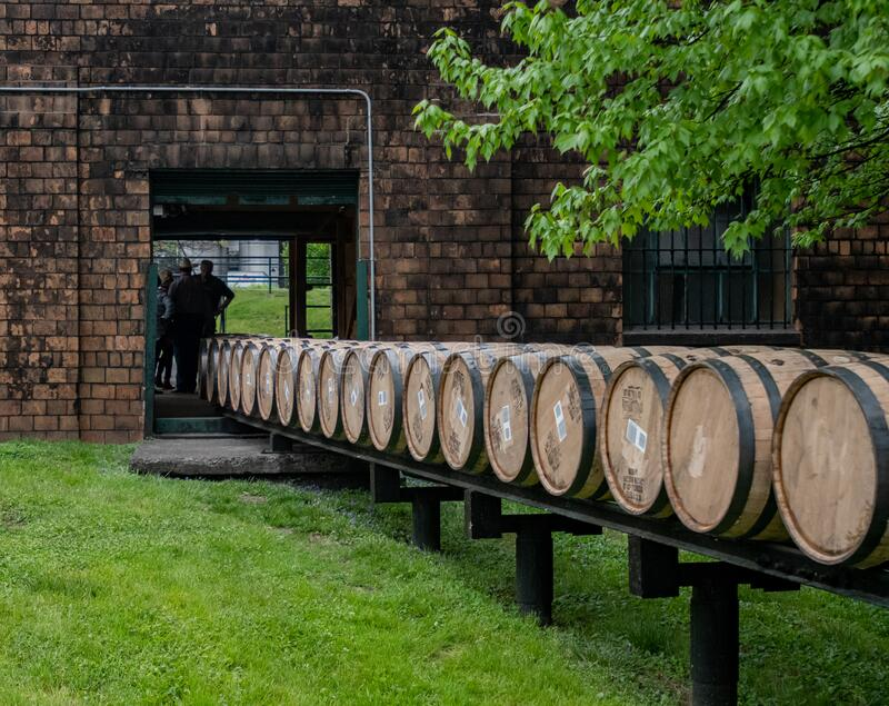 Barrels Roll Through Building. Versailles, United States: May 3, 2018: Barrels Roll through building at historic distillery on the Kentucky bourbon trail royalty free stock photo