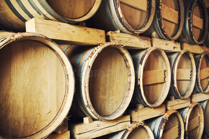 Barrels stacked in a wine cellar stock image
