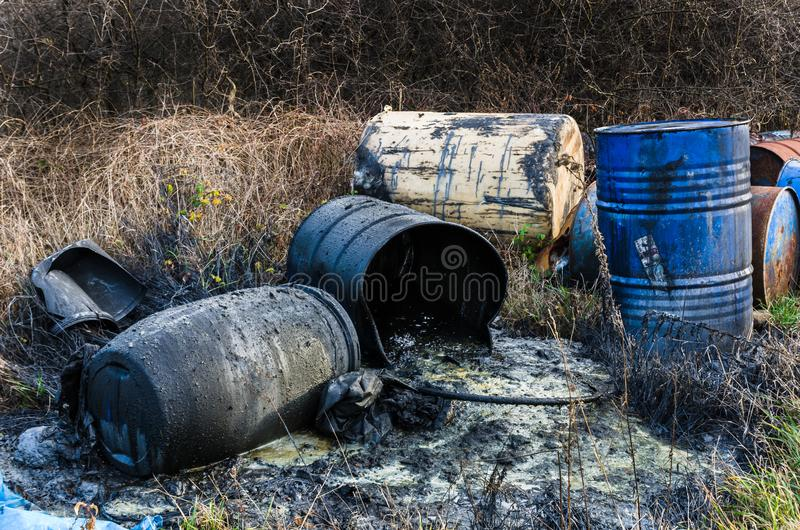 Barrels of toxic waste in nature. Pollution of the environment royalty free stock photos
