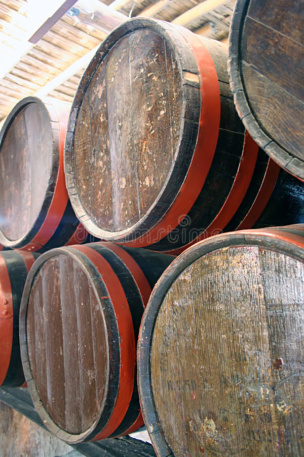 Barrels in a wine cellar. A detailed picture of barrels in a bodega stock images