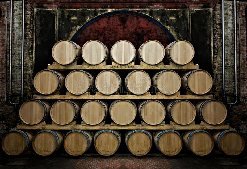 Barrels in a wine-cellar stock images