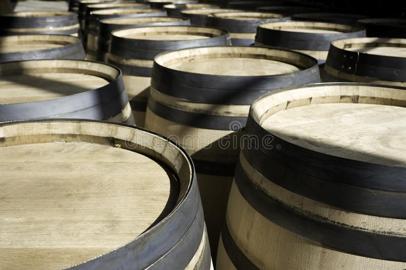Barrels for wine stacked outside in rows stock image