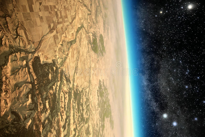 Barren dead planet in space. Surface of barren dead planet in space viewed from ninety degree angle