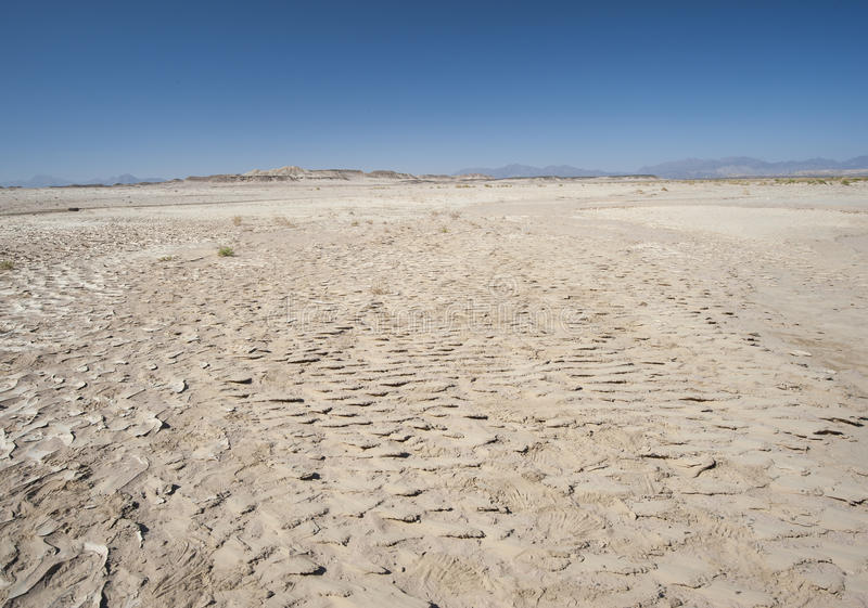 Barren desert landscape in hot climate stock photography