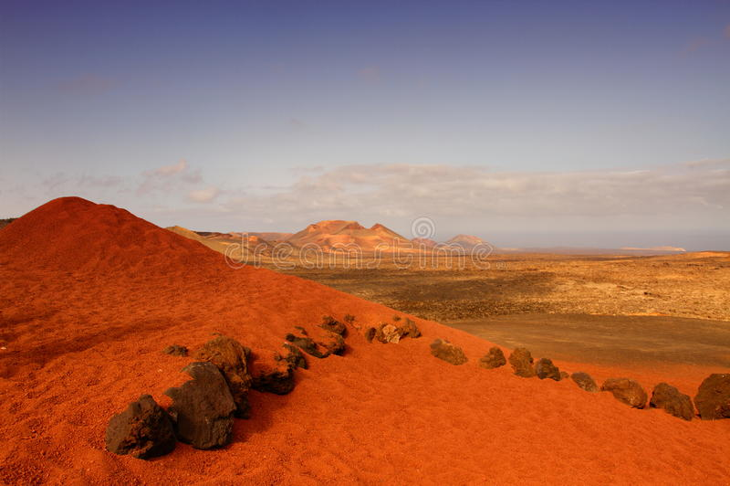 Barren landscape. A view of the red desert alien landscape of Lanzarote, canary islands