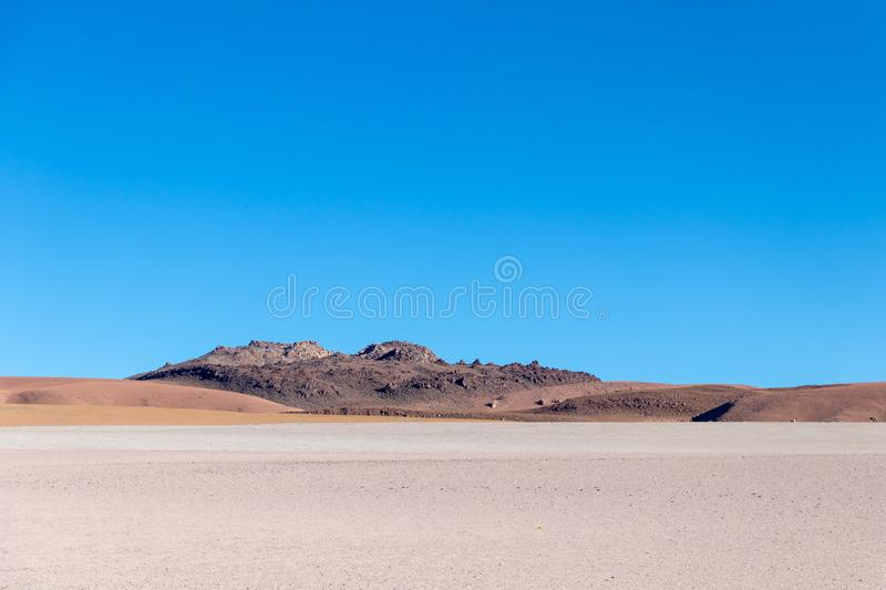 Background with barren desert scenery in the Bolivian Andes, in the Nature reserve Edoardo Avaroa stock photography