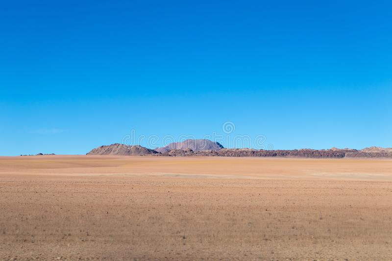 Background with barren desert scenery in the Bolivian Andes, in the Nature reserve Edoardo Avaroa royalty free stock image