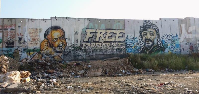 Barrière de la Cisjordanie avec des peintures murales des chefs palestiniens photo stock
