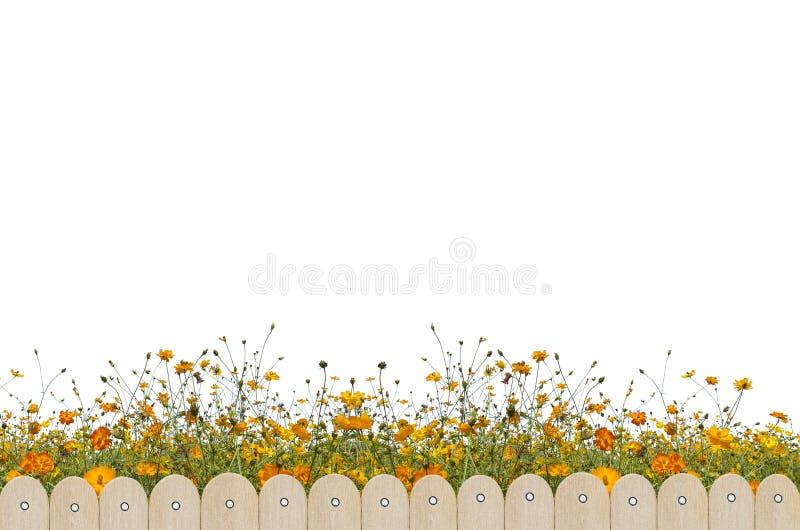 Barrière et fleur en bois images stock